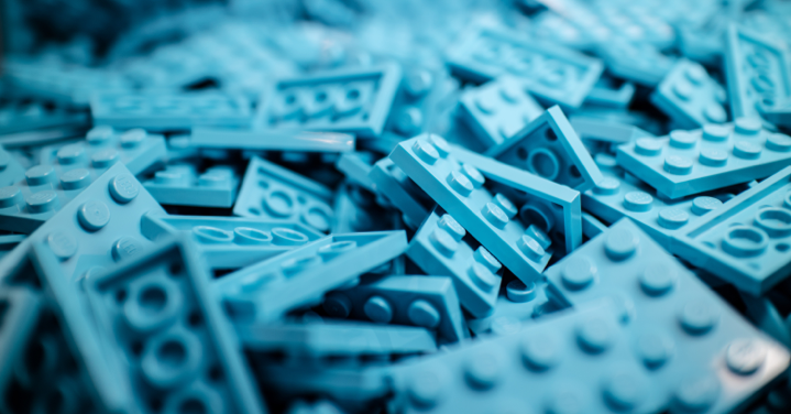 Sky-blue lego blocks piled haphazardly on top of each other
